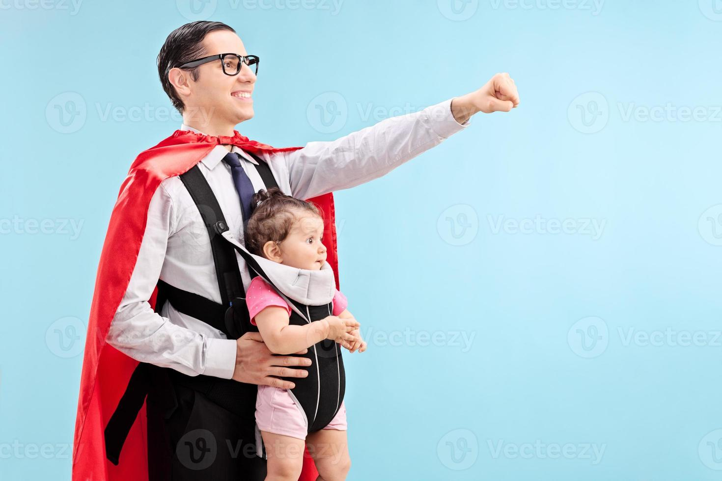 Proud father carrying his daughter photo