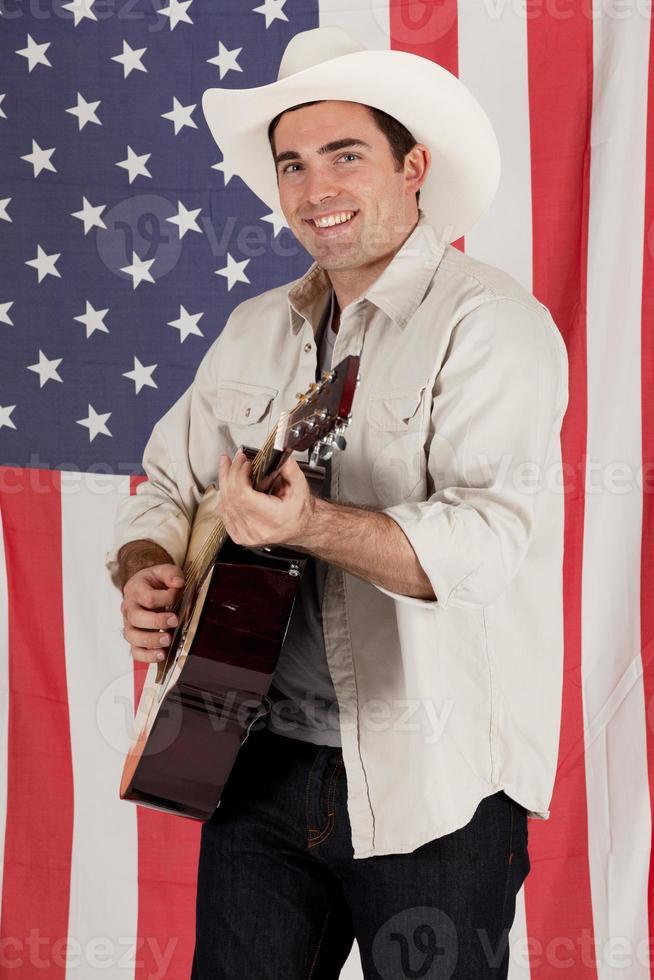 Cowboy playing a guitar photo
