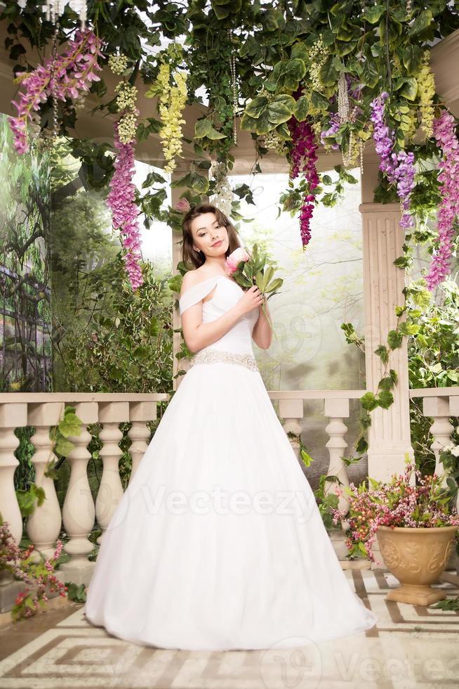 Beauty woman in white dress. Bride, wedding in garden. Brunette photo