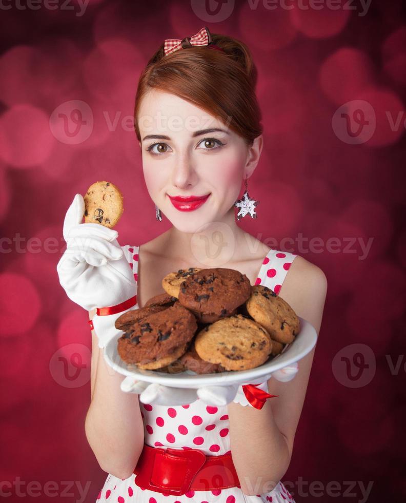 Beautiful redhead women with coockie photo
