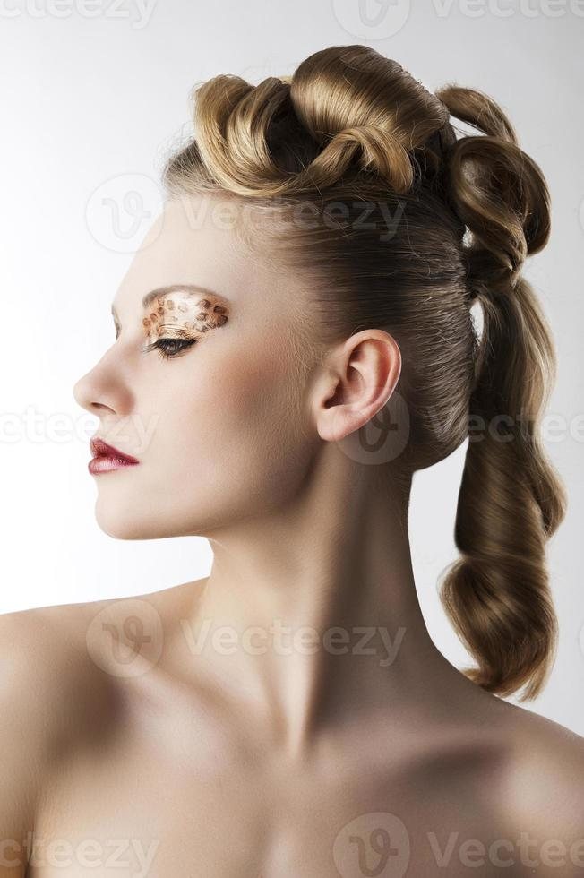 fashion girl with leopard makeup, she is turned in profile photo