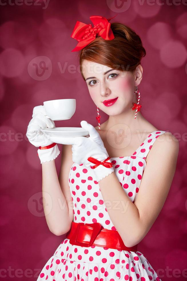 Beautiful redhead women with cup of tea. photo