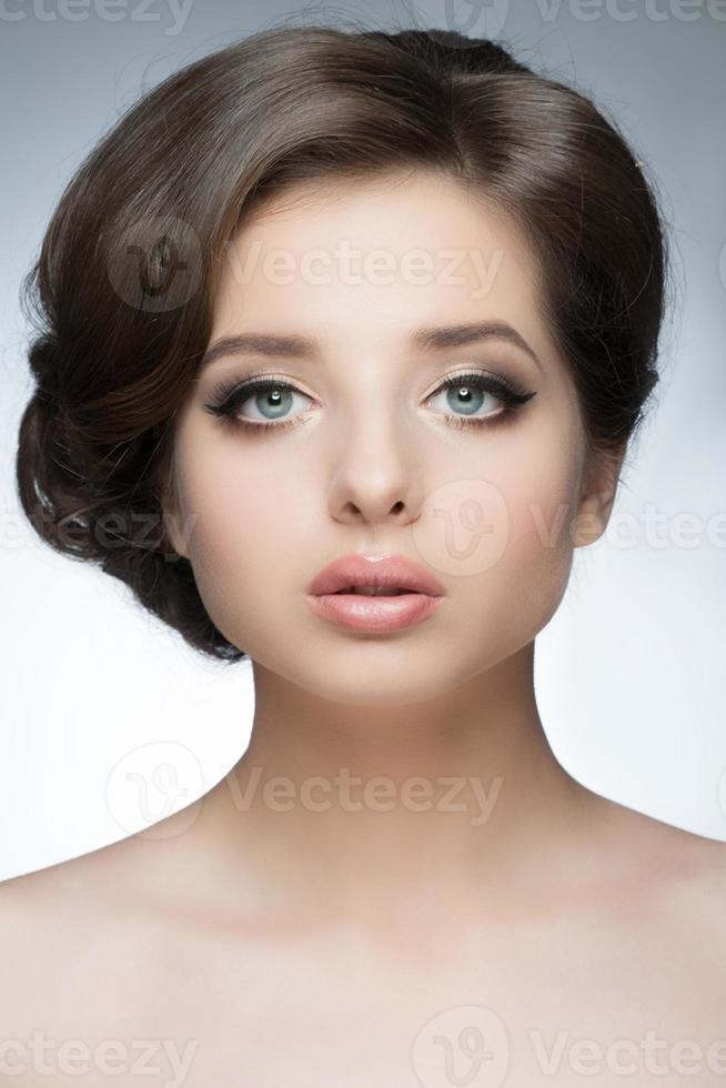 Girl with bridal hairstyle and makeup photo