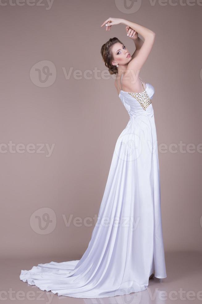 Fiancee. Girl in white dress photo