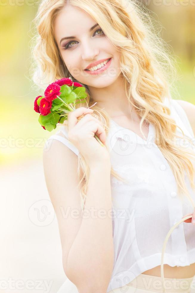 Portrait of a beautiful young blonde woman photo