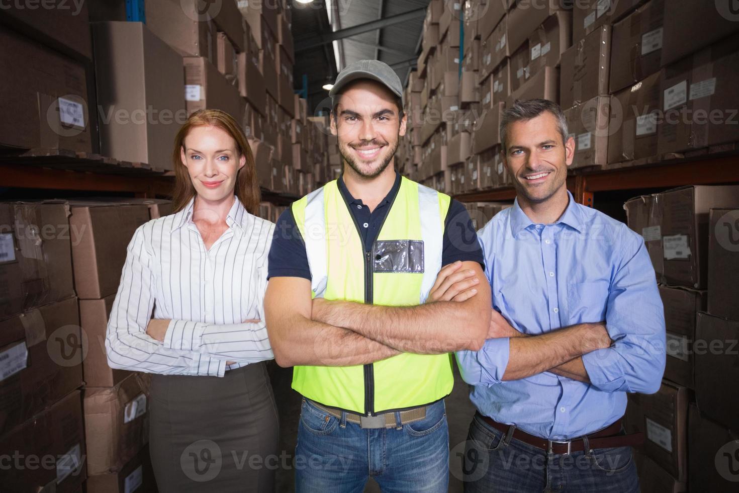Warehouse team smiling at camera showing thumbs up photo
