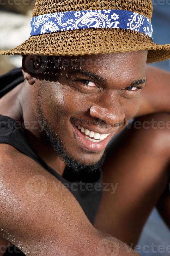 Handsome young black man smiling with hat photo