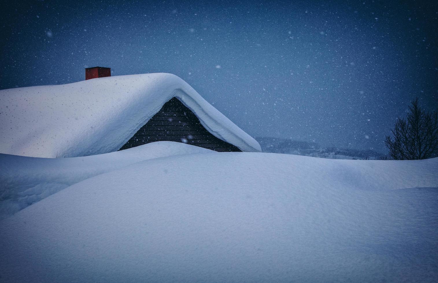 Snow coated house photo