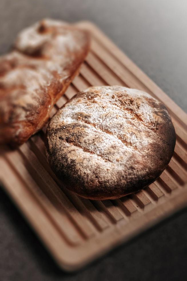 Baked bread on cutting board  photo