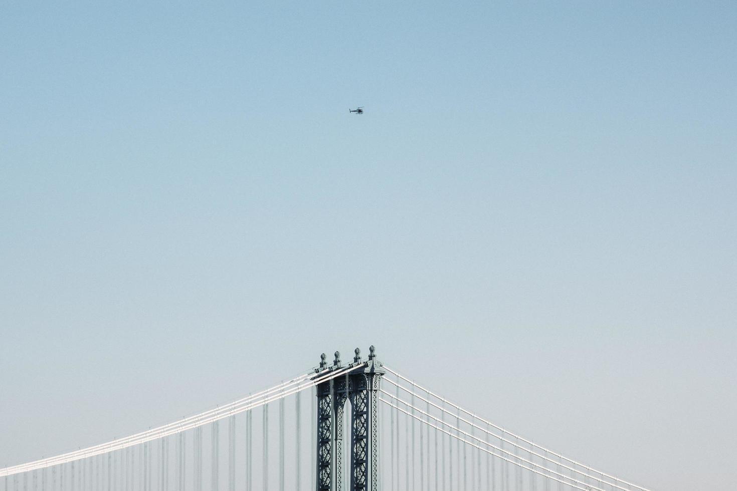 Minimal perspective of bridge at daytime photo