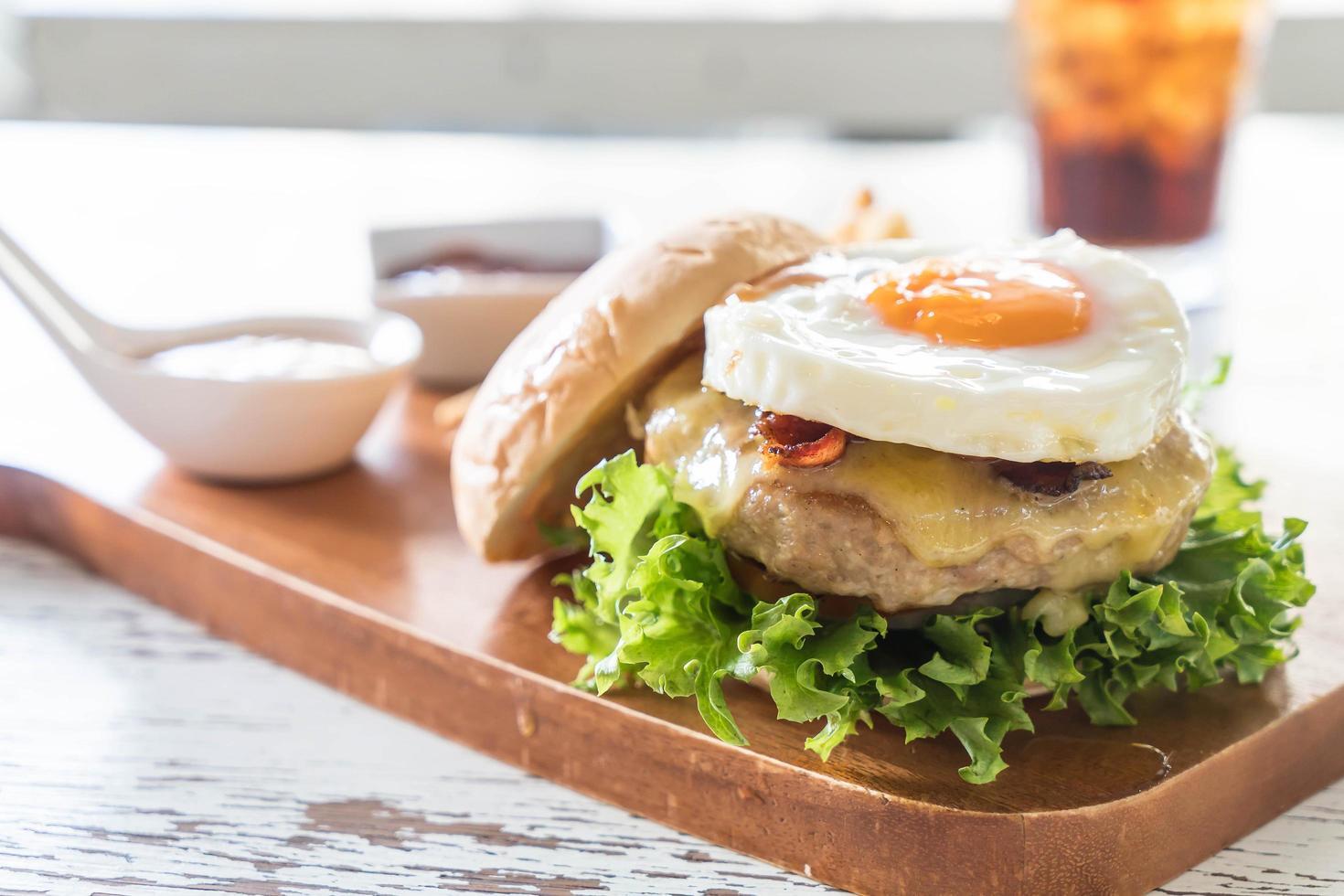 Hamburger with egg on it photo