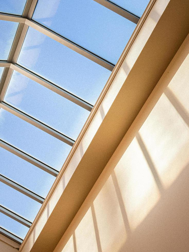 Windows above beige wall photo