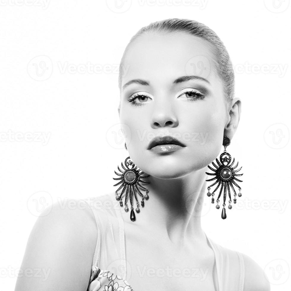 Portrait of beautiful young woman with earring photo