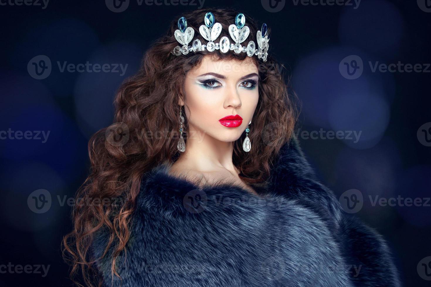 Beautiful brunette woman in mink fur coat. Jewelry. Fashion photo