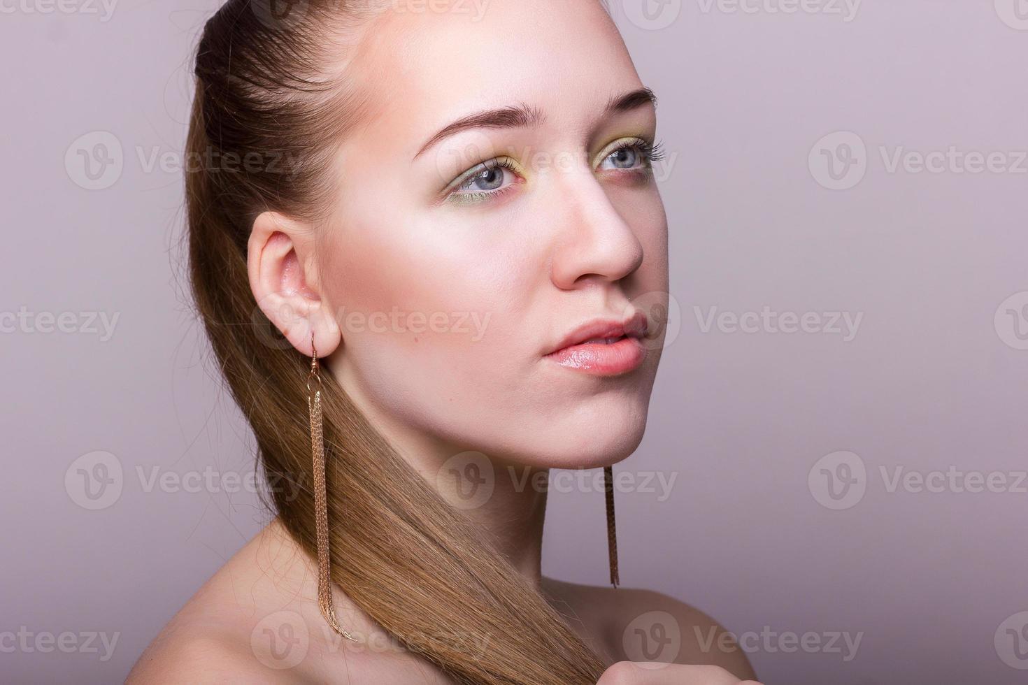 Studio beauty portrait of a beautiful young woman photo