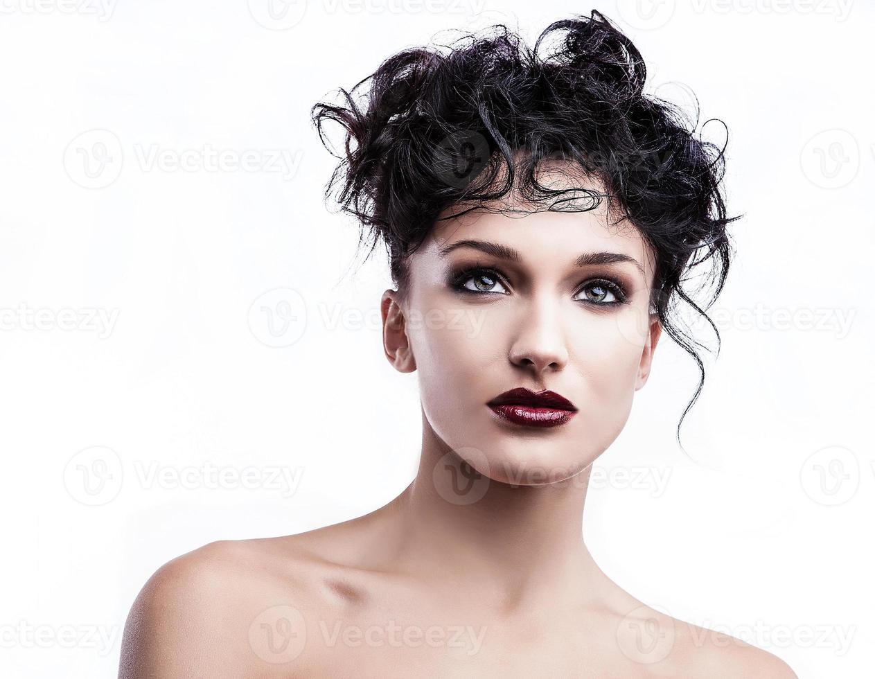Portrait of a young beauty. Close-up studio photo. photo