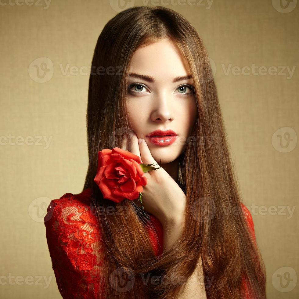 Portrait of beautiful dark-haired woman with flowers photo