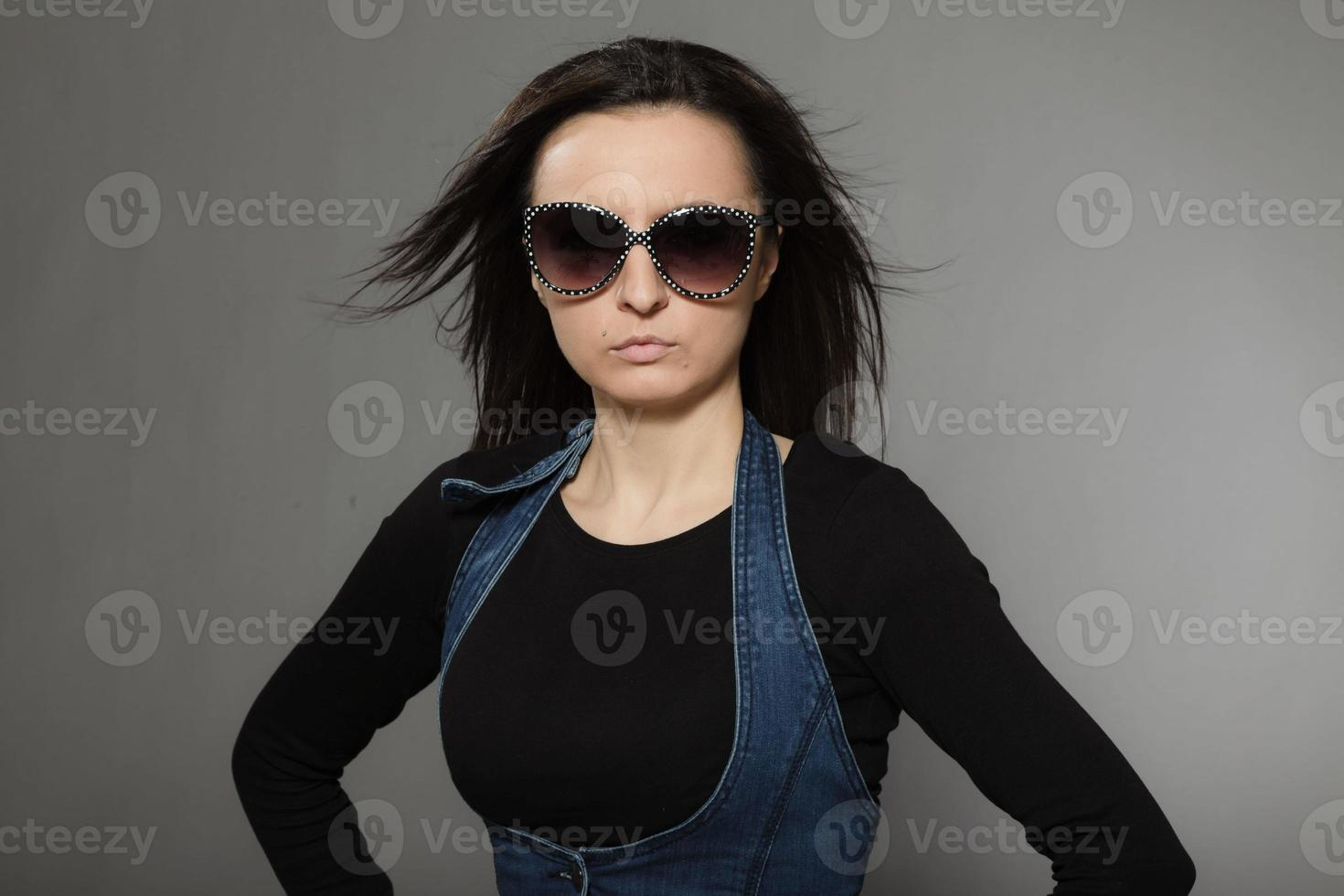 Fashion portrait of stylish young pretty woman with brown hair. photo