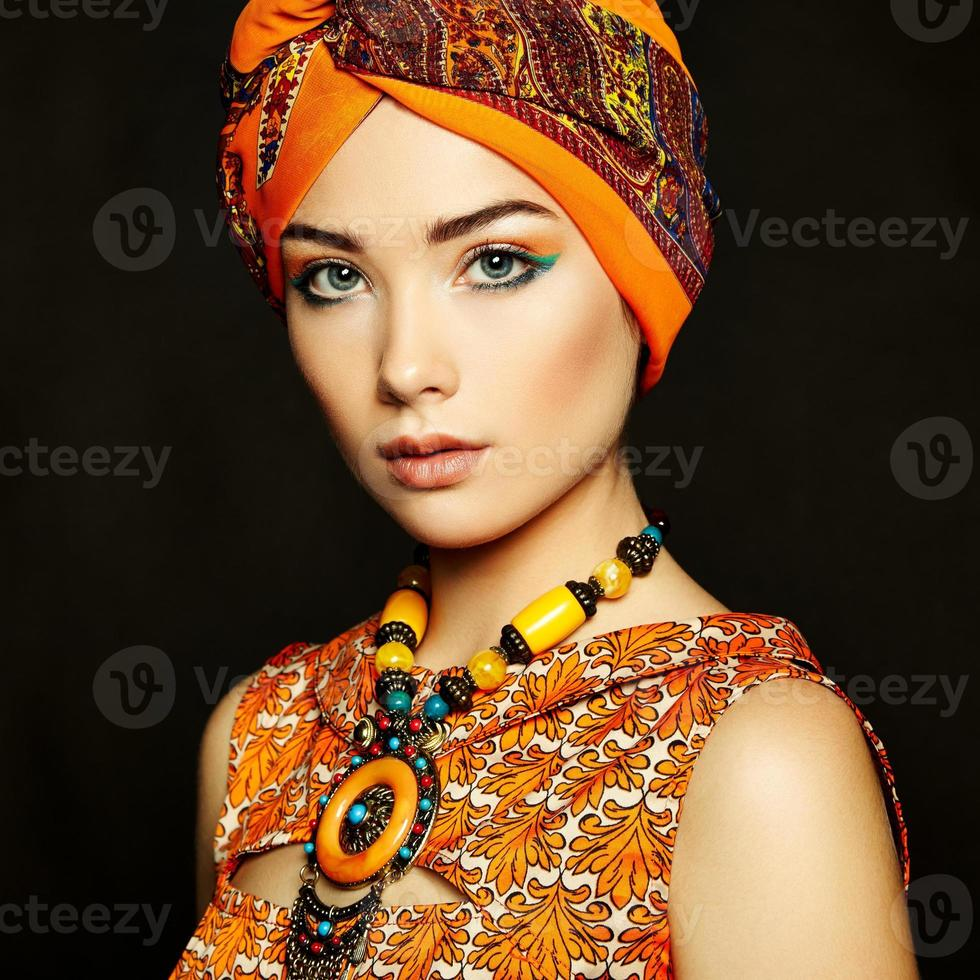 Portrait young beautiful woman with necklace photo