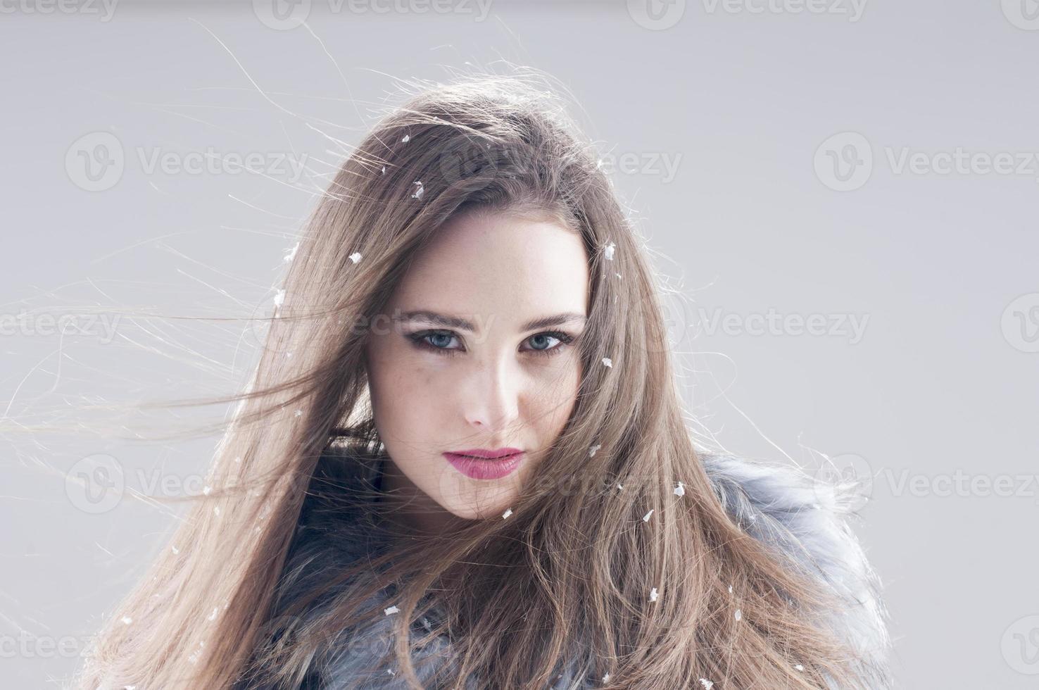 sensual girl in a fur coat photo