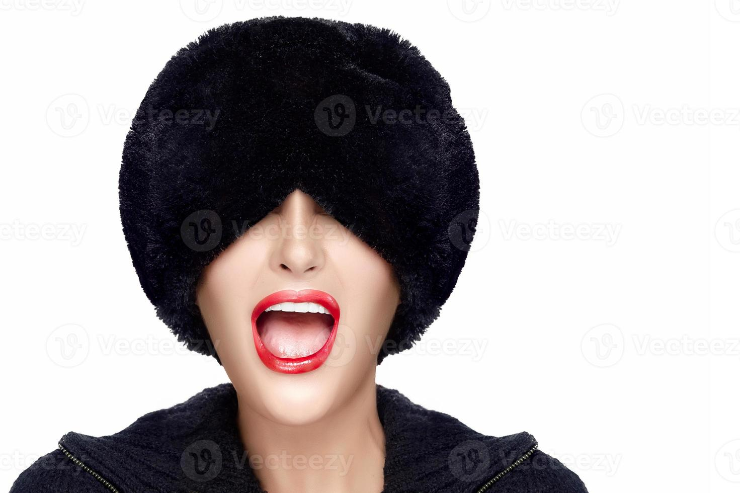 Winter Fashion Young Woman in Fur Hat Gesturing and Grimacing photo