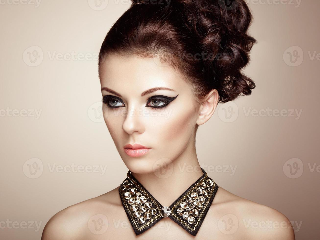 Portrait of beautiful sensual woman with elegant hairstyle photo