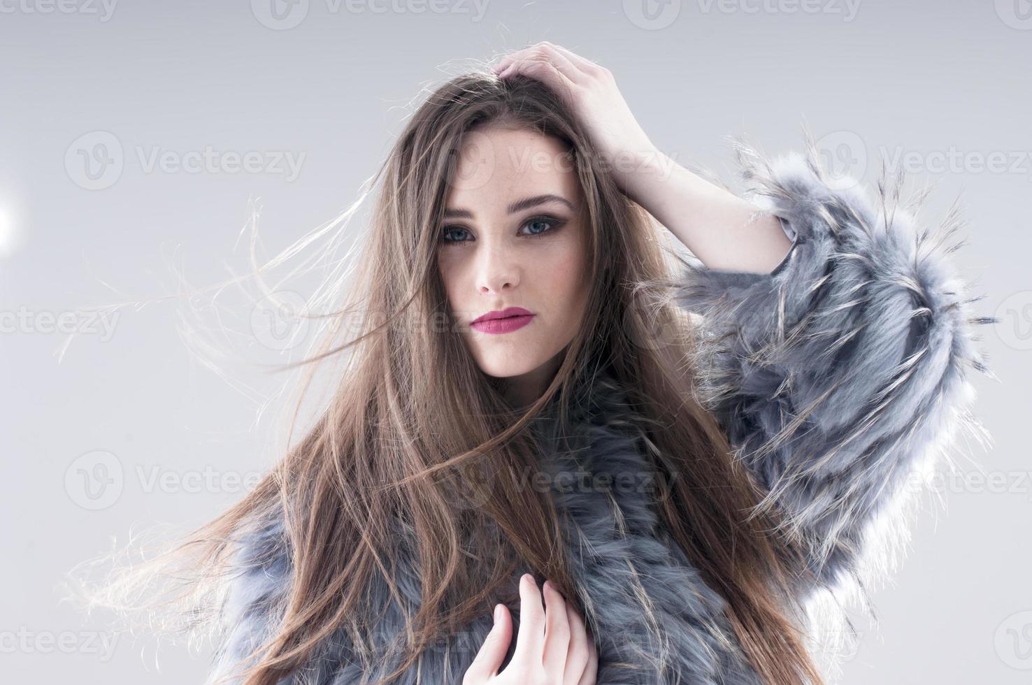 sensual girl in a coat photo