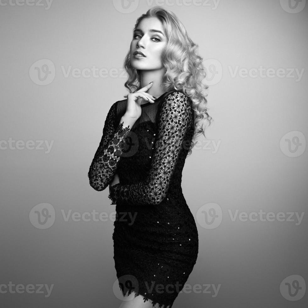 Fashion portrait of elegant woman with magnificent hair photo