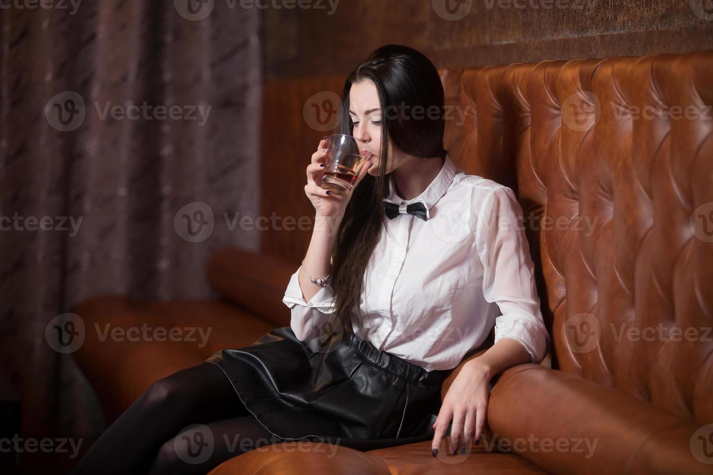 Beautiful girl drinking alcohol photo