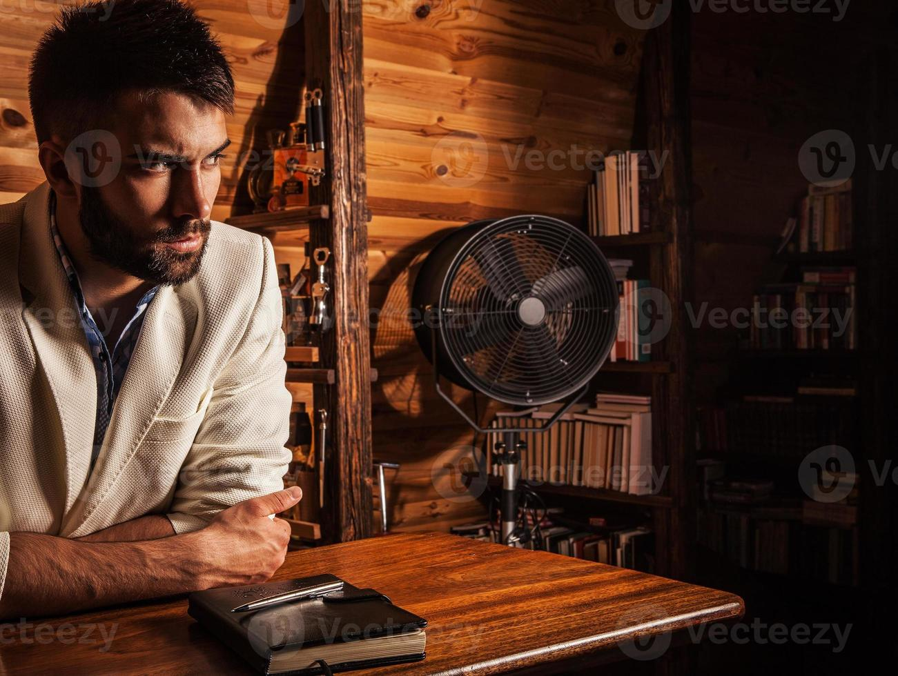 Young attractive bearded men pose in modern room. Close-up photo. photo