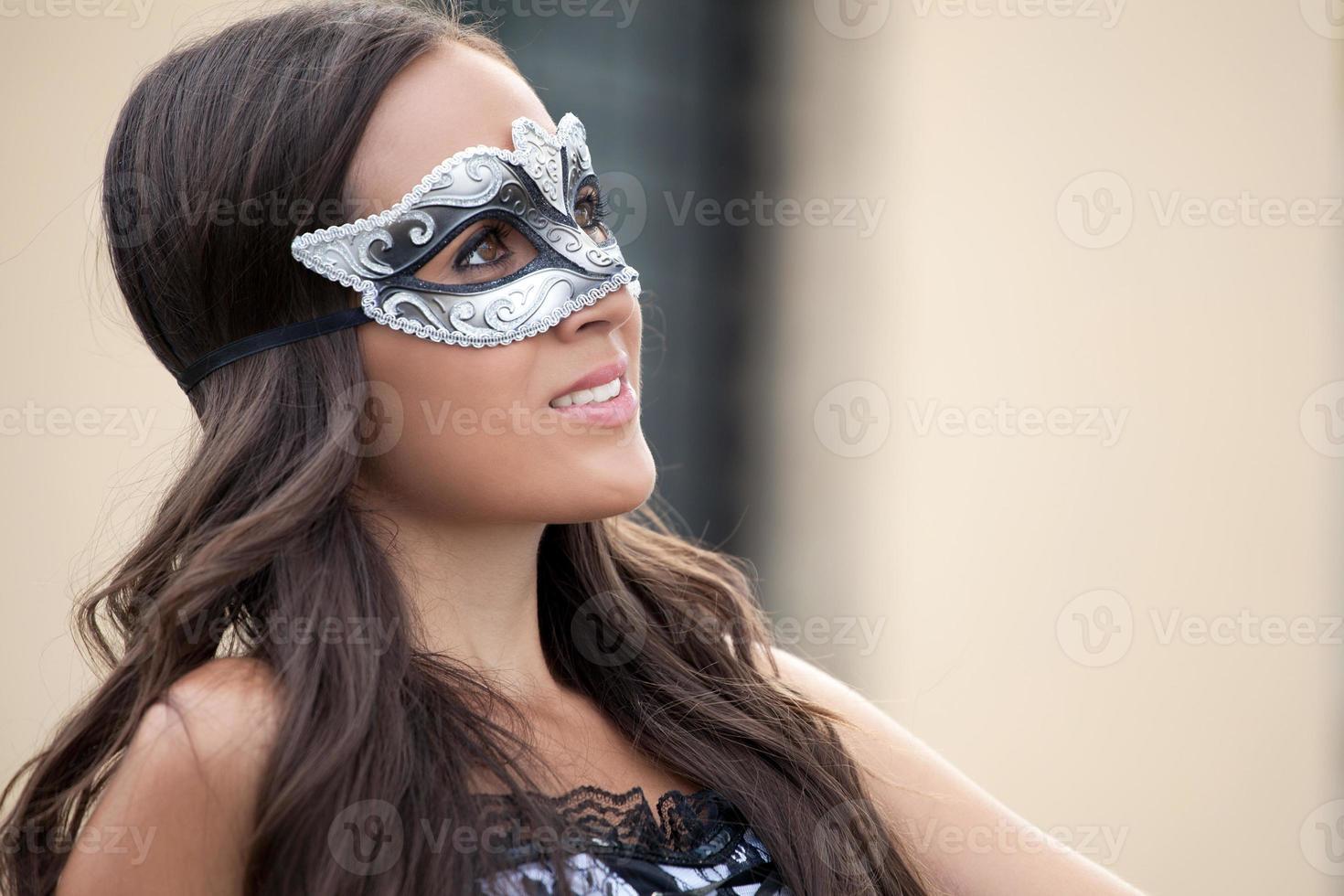 hermosa mujer en máscara veneciana foto