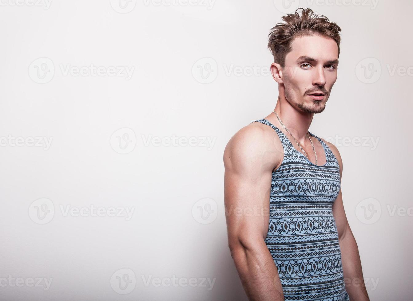 Young handsome man in turquoise T-shirt. photo