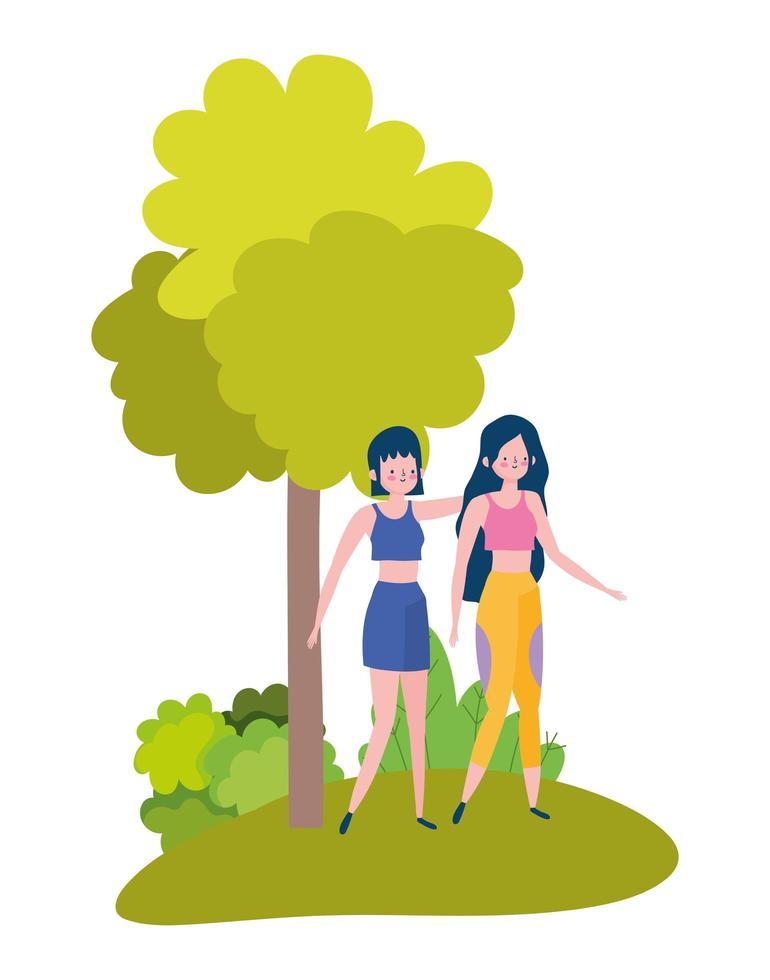 mujeres jóvenes caminando en el parque vector
