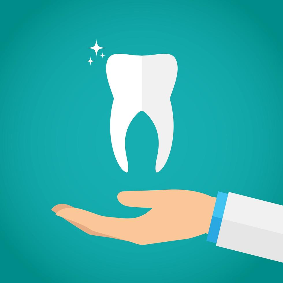 mano sosteniendo el diente vector