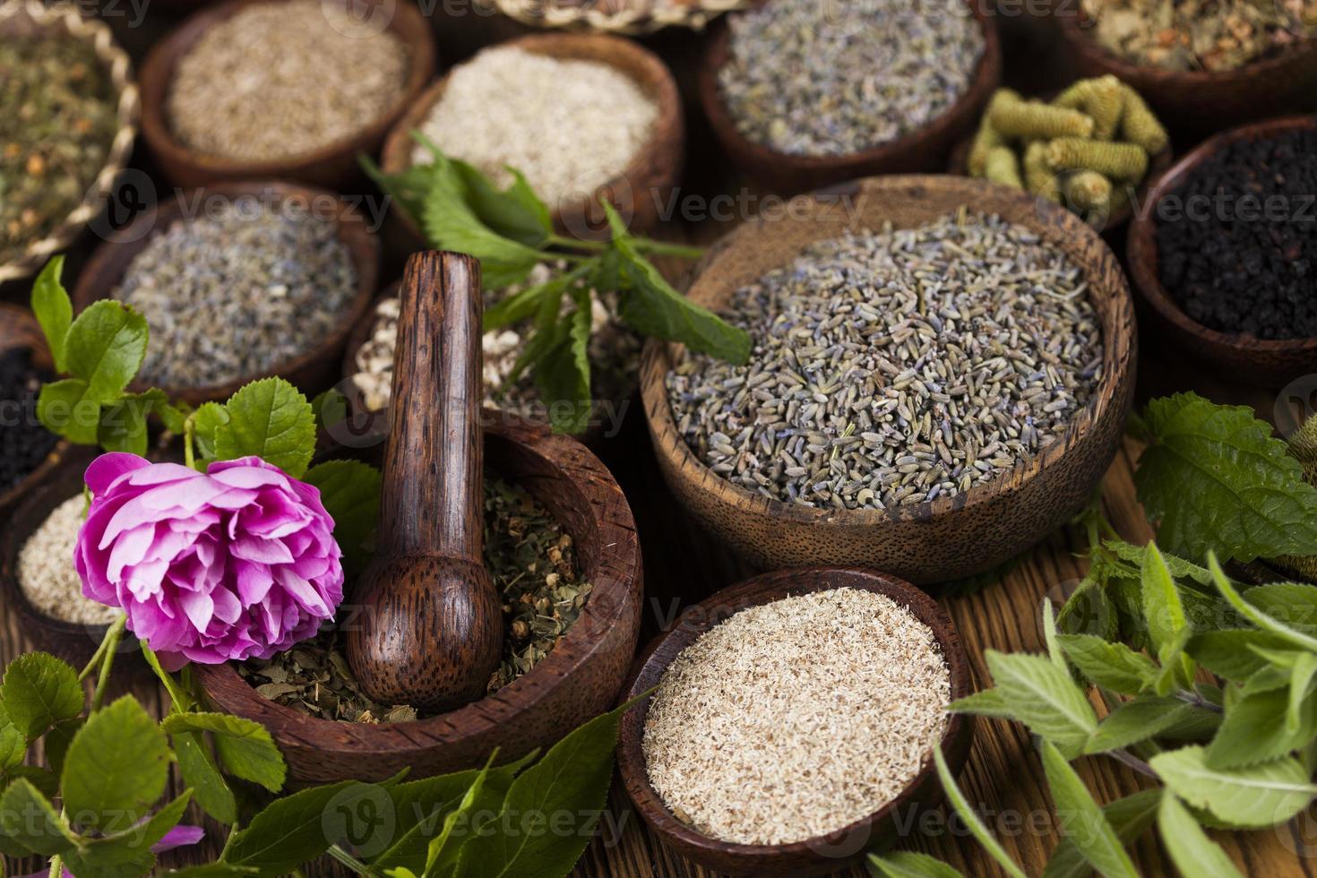 Alternative medicine, dried herbs background photo