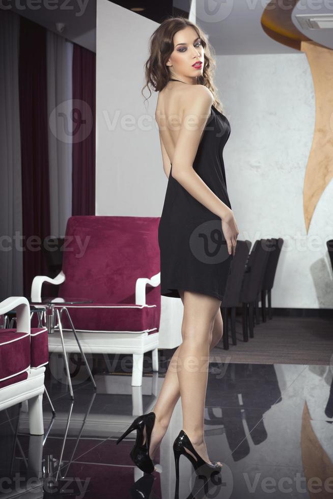 Beautiful woman in posing in hotel lobby photo