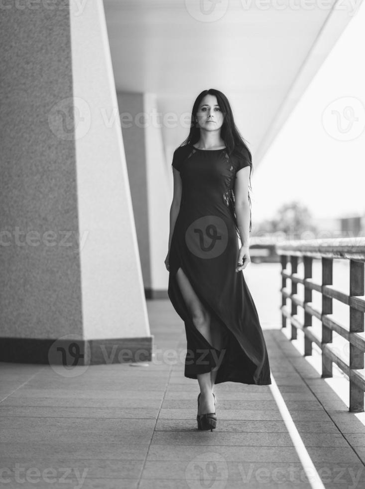 Photo of beautiful lady in elegant dress.