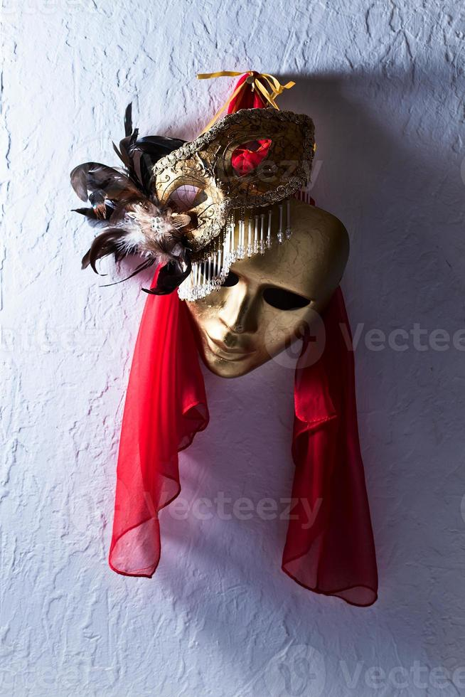 Venetian masks on  old wall photo