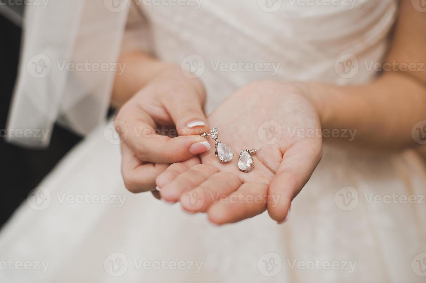 The bride shows ornaments. photo