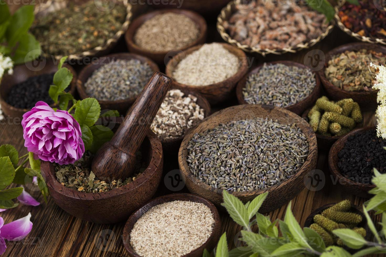 Natural medicine, wooden table background photo