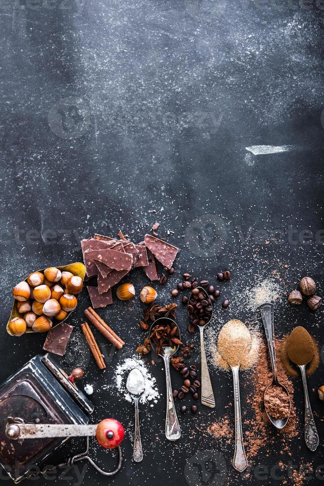 Sweet spices  and chocolate on a table photo