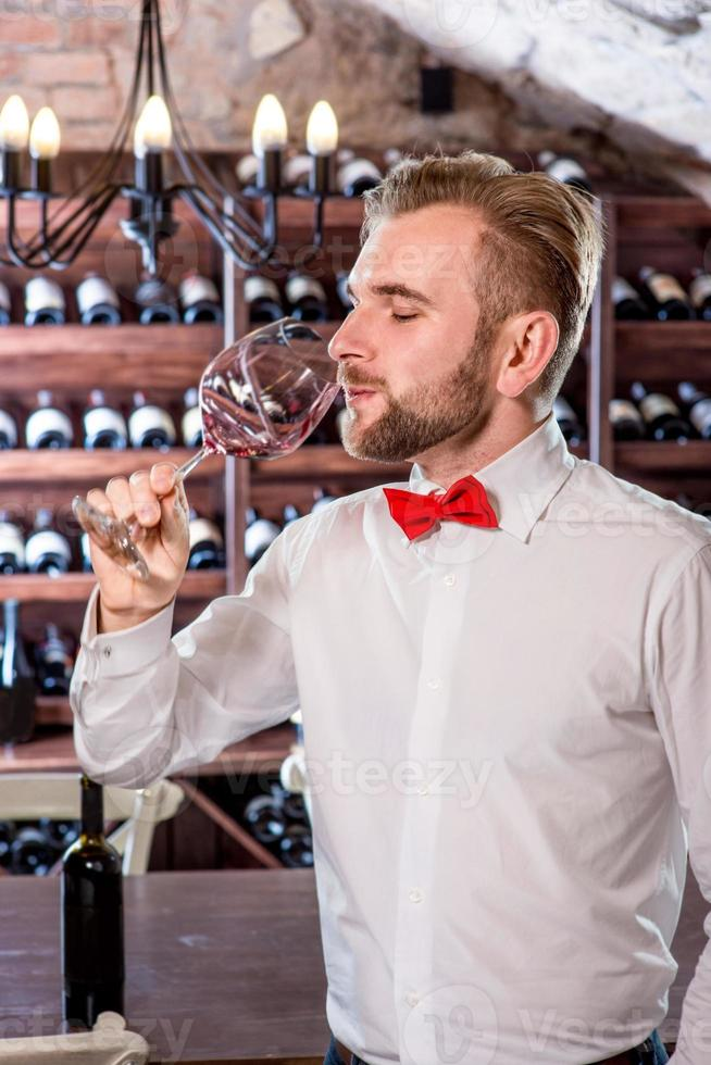 Sommelier in the wine cellar photo