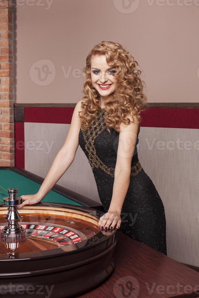 Blonde woman in casino photo