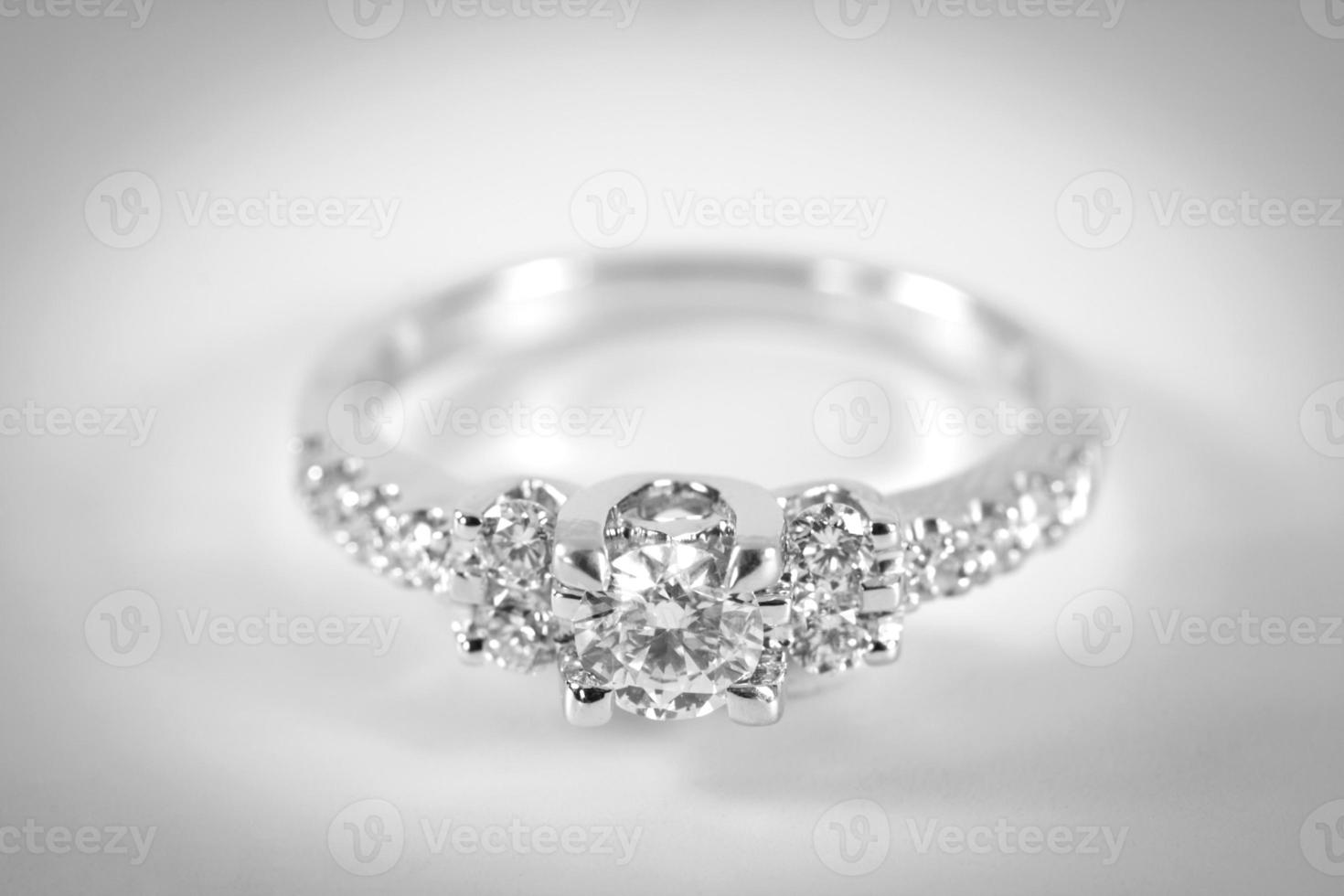 The engagement ring on white background. photo