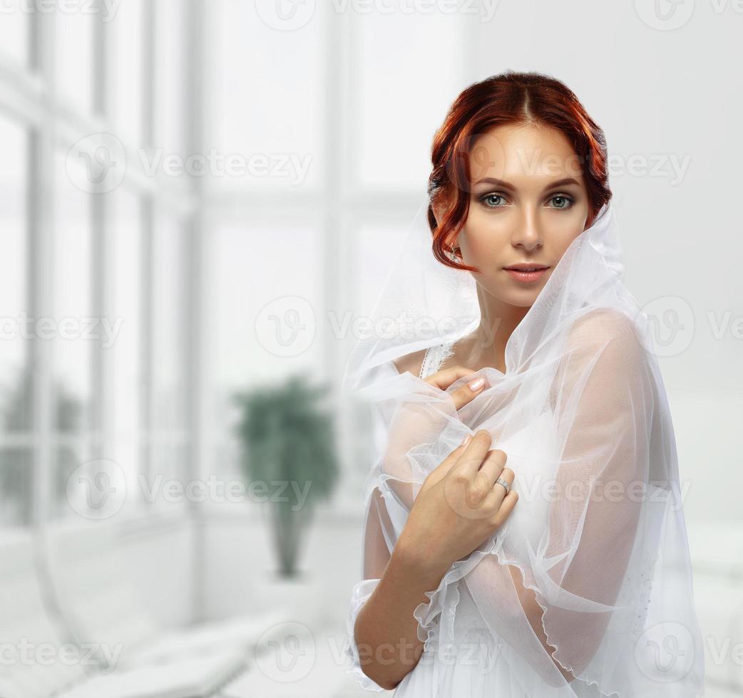 Portrait of Beautiful Young Fashion Bride in interior photo