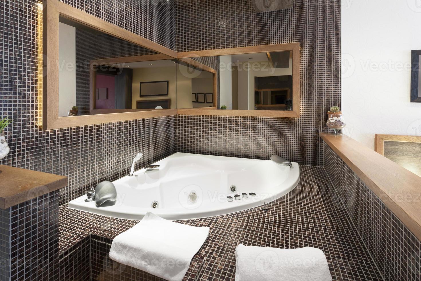 hot tub in hotel room interior photo