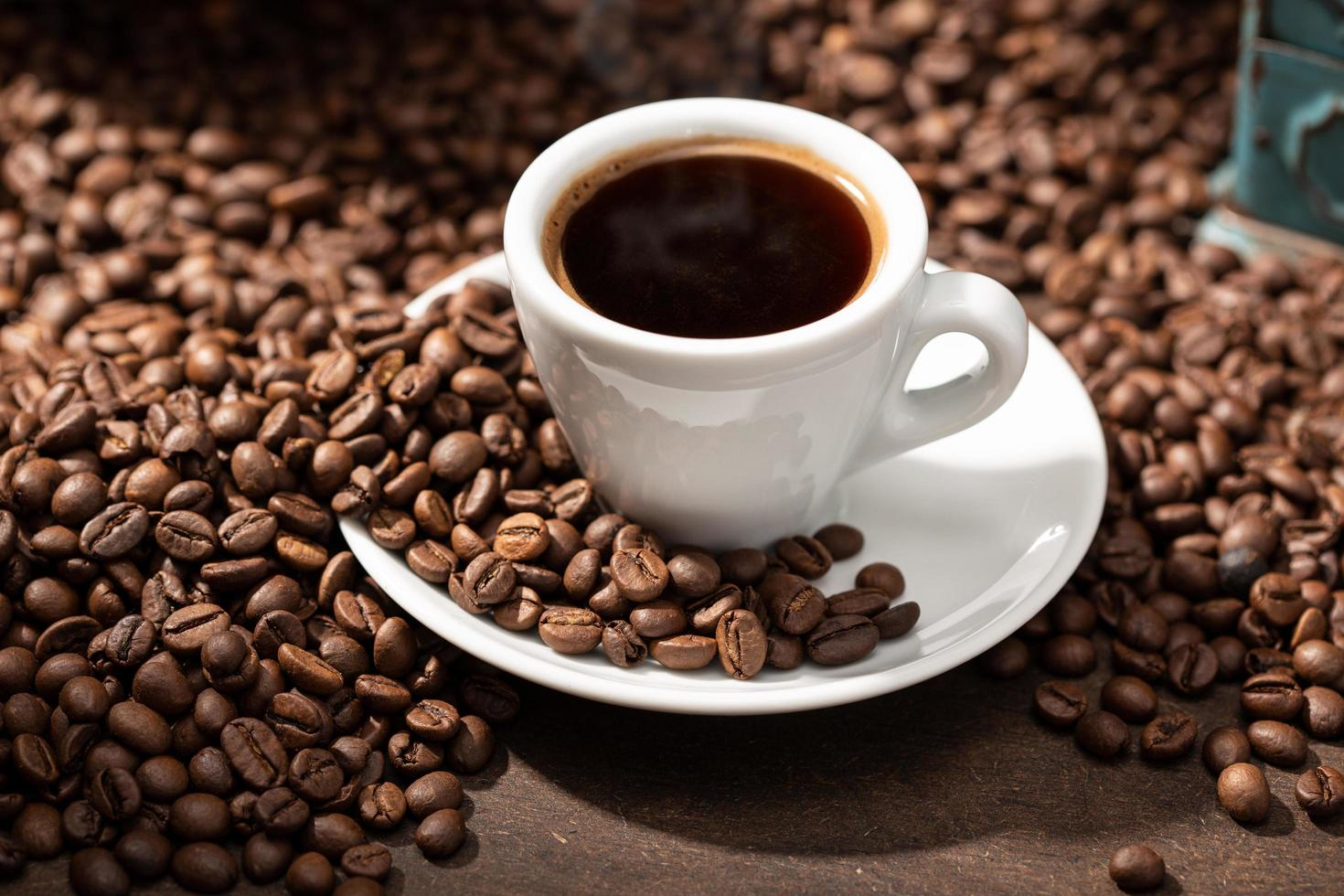 Espresso coffee cup and roasted beans photo
