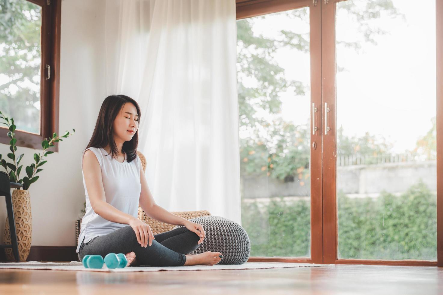 Asian woman doing yoga meditation 1264121 Stock Photo at Vecteezy