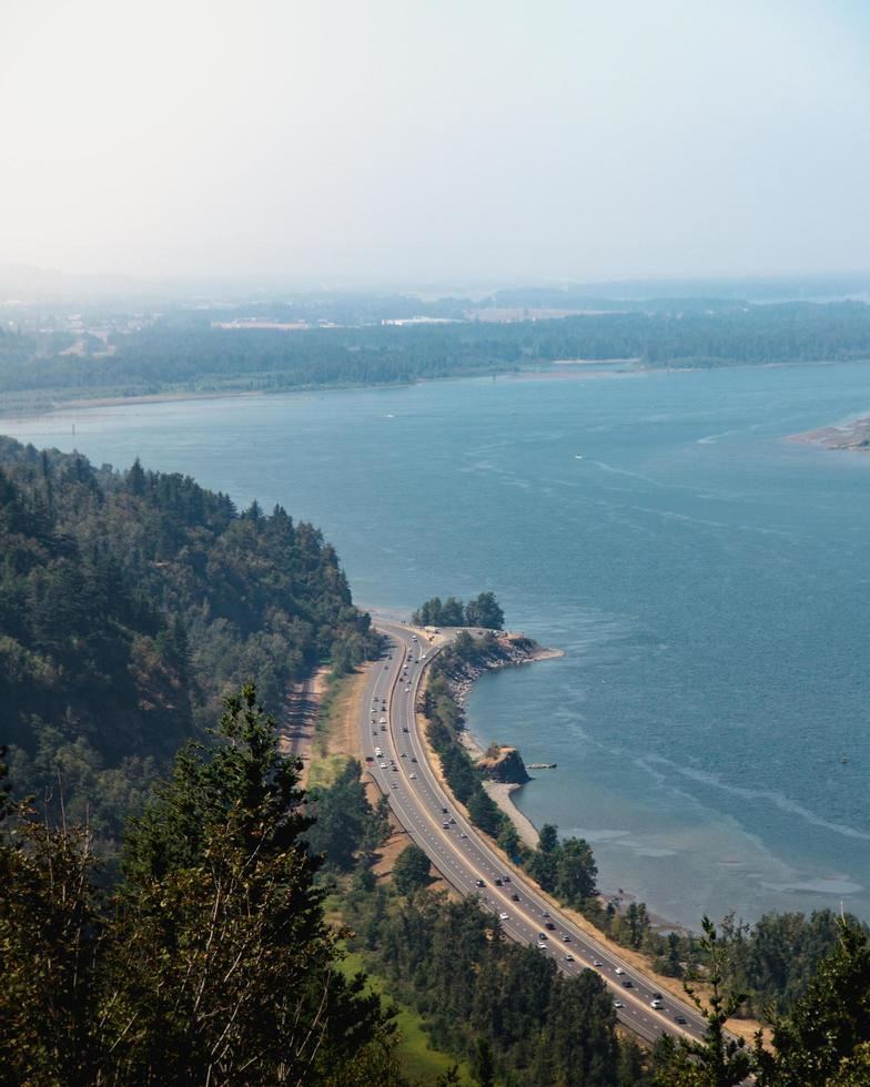 Aerial view of road near mountains and the ocean photo