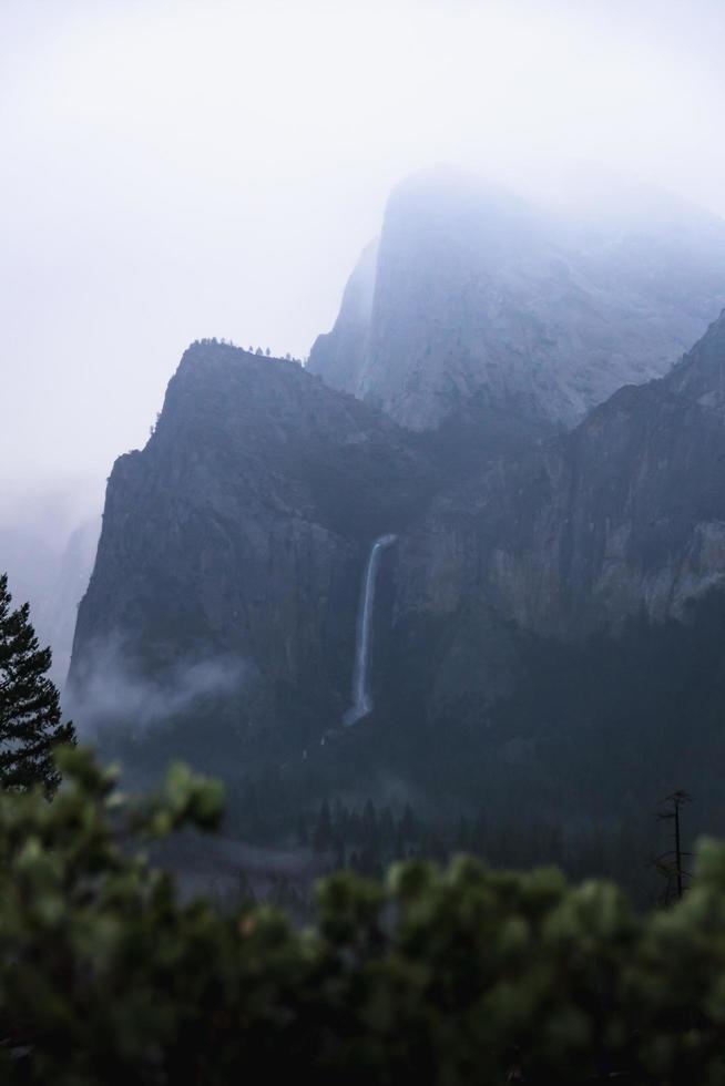 Waterfall on mountain cliff photo